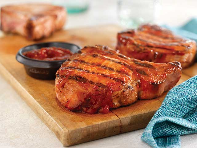 Grilled Ribeye (Rib) Pork Chops with Easy Spicy BBQ Sauce